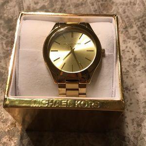 Gold Micheal Khors watch